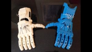 Two 3D printed biotic limbs in different colors, blue and white.