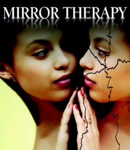 Woman looking in mirror with a cracked reflection